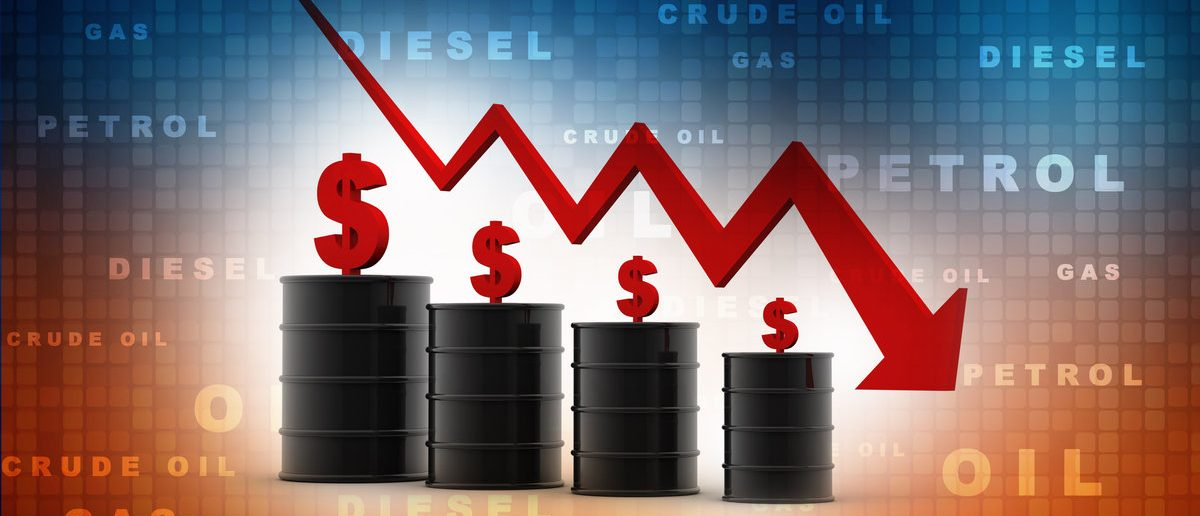 3d image of oil barrels with graph falling (Shutterstock/jijomathaidesigners)
