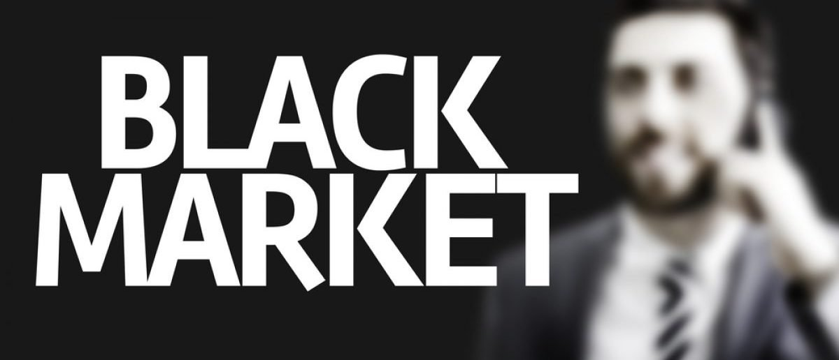 Business man with the text Black Market in a concept image. (Credit: Gustavo Frazao/Shutterstock)