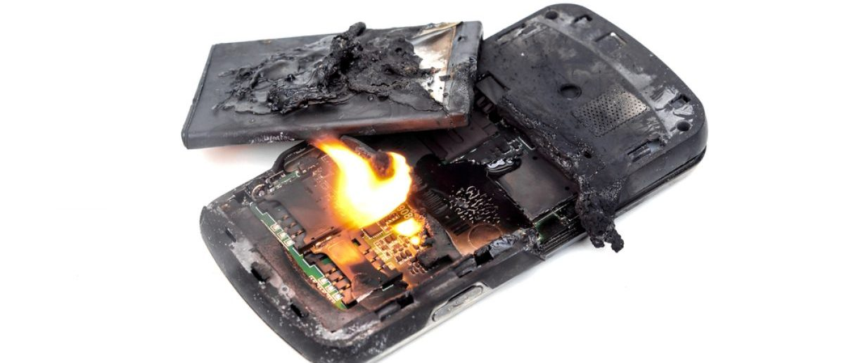 An unidentified mobile phone battery explodes and burns due to overheating. [Shutterstock - wk1003mike - 327590033]