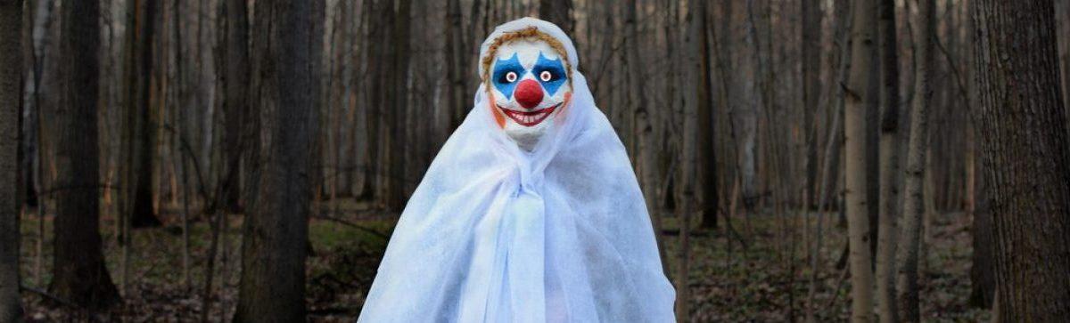 Clown in the woods. (Shutterstock/Kobzev Dmitry)