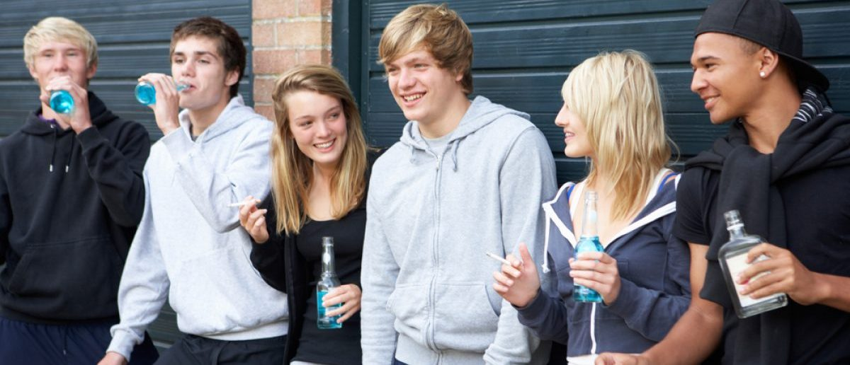 Group Of Teenagers Hanging Out Together Outside Drinking [Shutterstock - Monkey Business Images - 71235025]