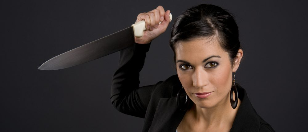 Woman holding knife (Shutterstock)
