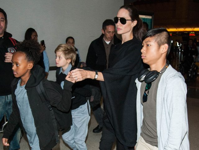 "Shiloh Jolie-Pitt fashion statement ""Einstein was a refugee"" t-shirt with mom Angelina Jolie and siblings, Pax, and Zahara, at LAX airport"