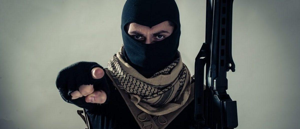 Terrorist threatening the West. oneinchpunch/Shutterstock.