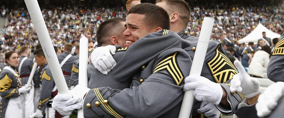 Members of the graduating class embrace at the end of the commencement ceremony at the United States Military Academy at West Point, New York, May 28, 2014. U.S. President Barack Obama's commencement address was the first in a series of speeches that he and top advisers will use to explain U.S. foreign policy in the aftermath of conflicts in Iraq and Afghanistan and lay out a broad vision for the rest of his presidency. REUTERS/Kevin Lamarque.