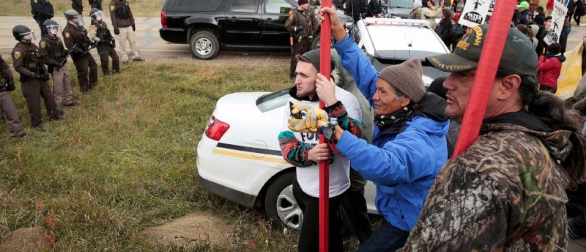 Dakota Access Pipeline protesters square off against police between the Standing Rock Reservation and the pipeline route outside the little town of Saint Anthony, North Dakota, U.S., October 5, 2016.