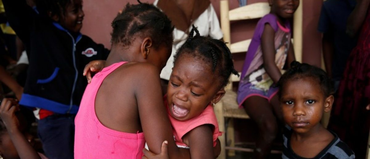 A girl cries as she stays with her relatives at a partially destroyed school in Jeremie.