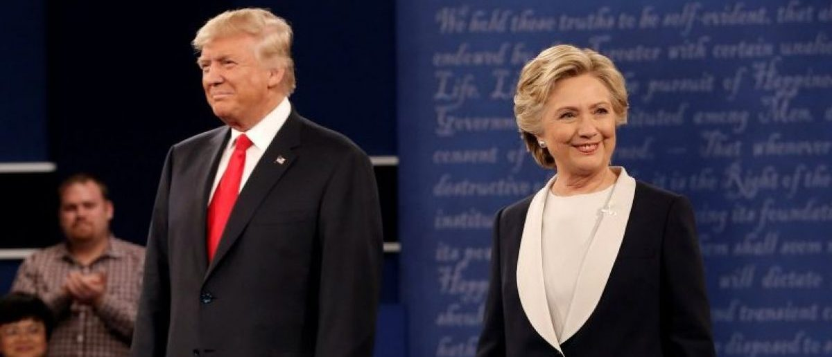 Republican U.S. presidential nominee Donald Trump and Democratic U.S. presidential nominee Hillary Clinton appear together during their presidential town hall debate at Washington University in St. Louis, Missouri, U.S., October 9, 2016.   REUTERS/Mike Segar