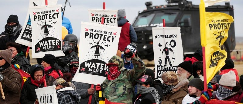 Dakota Access Pipeline protesters square off against police near the Standing Rock Reservation and the pipeline route outside the little town of Saint Anthony