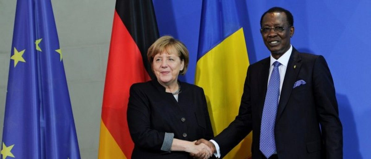 German Chancellor Angela Merkel and Chad President Idriss Deby shake hands after a news conference at the Chancellery in Berlin, Germany October 12, 2016. REUTERS/Stefanie Loos