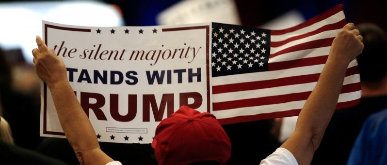 A supporter of Republican U.S. presidential nominee Donald Trump holds a sign at a Trump campaign rally in West Palm Beach