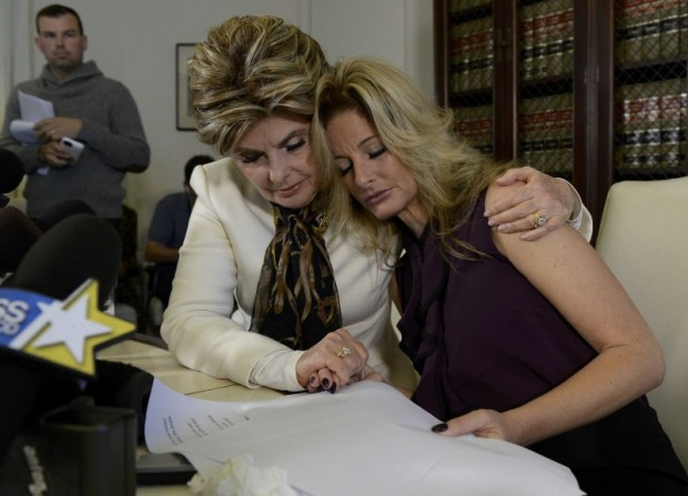 Summer Zervos, a former contestant on the TV show The Apprentice, is embraced by lawyer Gloria Allred (L) while speaking about allegations of sexual misconduct against Donald Trump during a news conference in Los Angeles, California, U.S. October 14, 2016. REUTERS/Kevork Djansezian TPX IMAGES OF THE DAY