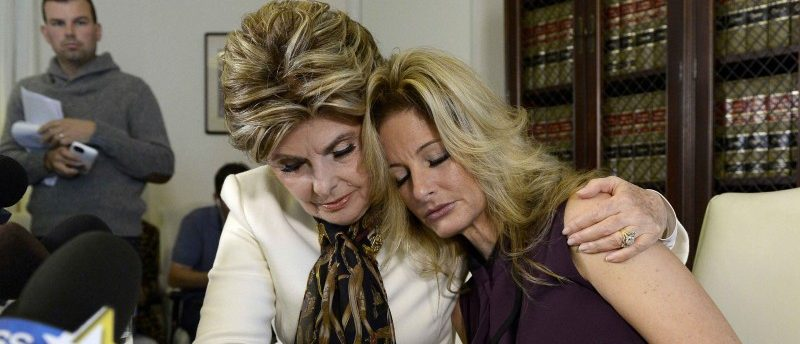 Summer Zervos, a former contestant on the TV show The Apprentice, is embraced by lawyer Gloria Allred (L) while speaking about allegations of sexual misconduct against Donald Trump during a news conference in Los Angeles, California, October 14, 2016. REUTERS/Kevork Djansezian