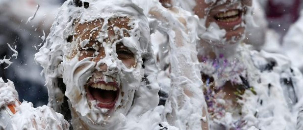 Students from St Andrews University are covered in foam as they take part in the traditional 'Raisin Weekend' in the Lower College Lawn, at St Andrews in Scotland, Britain October 17, 2016. REUTERS/Russell Cheyne