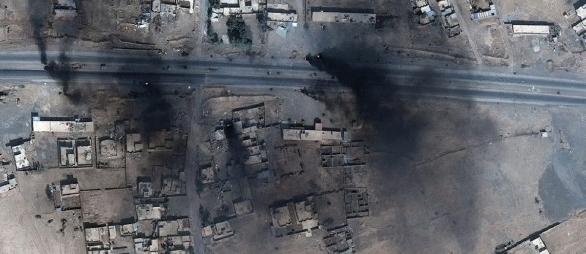 Smoke is seen in this satellite image of the city of Mosul.  Courtesy of Stratfor.com/AllSource Analysis/DigitalGlobe/Handout via REUTERS