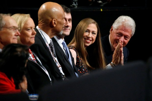 Former U.S. president Bill Clinton (R), daughter Chelsea Clinton (2nd R) and her husband Marc Mezvinsky (3rd R) greet people as they arrive to watch Democratic U.S. presidential nominee Hillary Clinton's third and final 2016 presidential campaign debate against Republican U.S. presidential nominee Donald Trump at UNLV in Las Vegas, Nevada, U.S., October 19, 2016. REUTERS/Jonathan Ernst