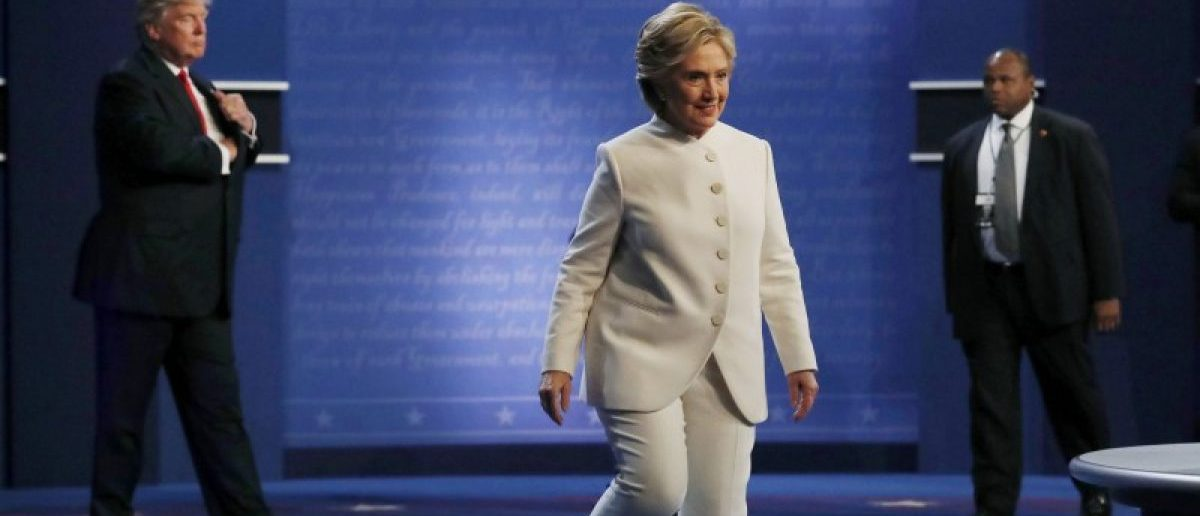 Democratic U.S. presidential nominee Hillary Clinton walks off the debate stage as Republican U.S. presidential nominee Donald Trump remains behind her after the conclusion of their third and final 2016 presidential campaign debate at UNLV in Las Vegas, Nevada, U.S., October 19, 2016. REUTERS/Carlos Barria