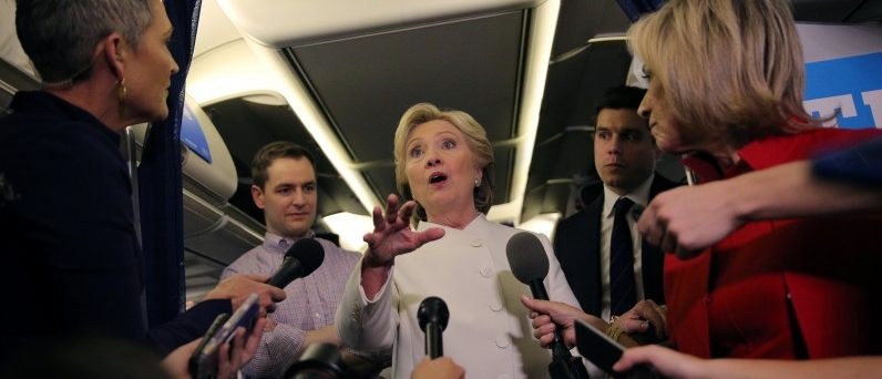 Democratic U.S. presidential candidate Hillary Clinton talks to the media inside of her campaign plane after the third and final 2016 presidential campaign debate in North Las Vegas, Nevada, U.S., October 19, 2016. REUTERS/Carlos Barria