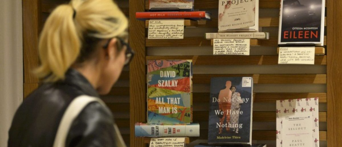 A woman looks at Man Booker Prize 2016 shortlisted books at a Waterstones book store in London, Britain, October 19, 2016. Picture taken October 19, 2016. REUTERS/Hannah McKay