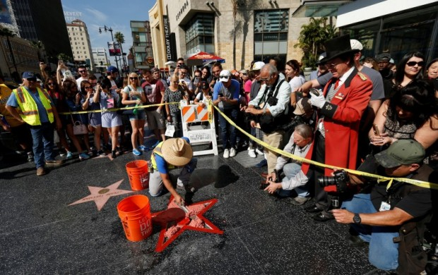 Cement is poured on Donald Trump's star on the Hollywood Walk of Fame after it was vandalized in Los Angeles, California U.S., October 26, 2016. REUTERS/Mario Anzuoni