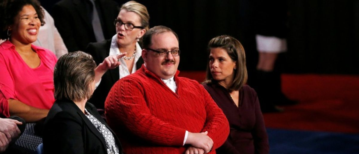 Ken Bone (C), a power plant employee from Belleville, Illinois, waits in the audience to ask a question about energy policy and jobs during the presidential debate between Republican U.S. presidential nominee Donald Trump and Democratic nominee Hillary Clinton at Washington University in St. Louis, Missouri, U.S., October 9, 2016. Picture taken October 9, 2016. REUTERS/Jim Bourg