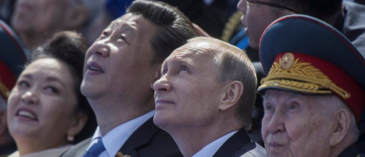 FILE PHOTO - Russia's President Vladimir Putin (2nd R) and China's President Xi Jinping (2nd L) watch the Victory Day parade at Red Square in Moscow, Russia, May 9, 2015. REUTERS/Host Photo Agency/RIA Novosti/File Photo