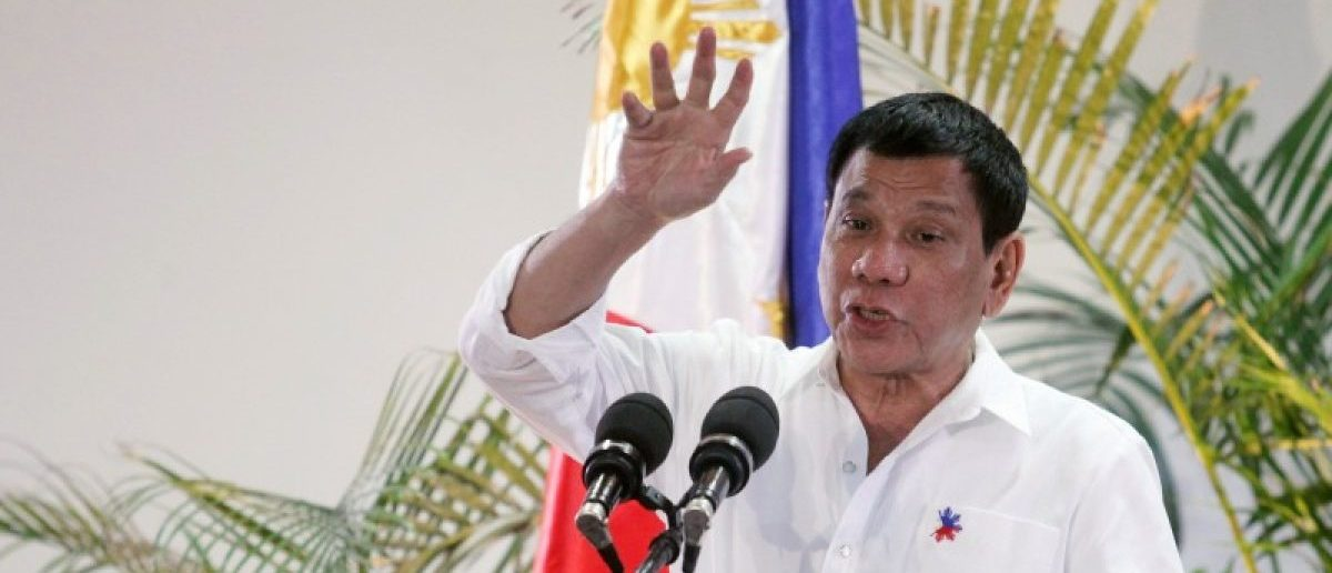 Philippine President Rodrigo Duterte gestures while answering questions during a news conference upon his arrival from a state visit in Japan at the Davao International Airport in Davao city, Philippines October 27, 2016. REUTERS/Lean Daval Jr