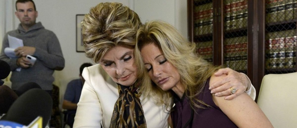 Summer Zervos, a former contestant on the TV show The Apprentice, is embraced by lawyer Gloria Allred (L) while speaking about allegations of sexual misconduct against Donald Trump during a news conference in Los Angeles, California, U.S. October 14, 2016. REUTERS/Kevork Djansezian