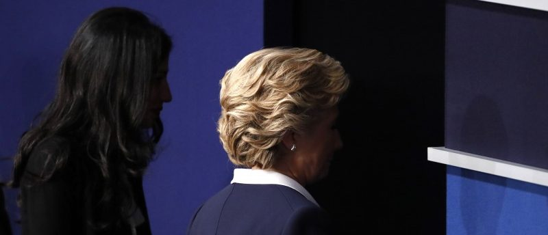 Democratic U.S. presidential nominee Clinton walks offstage with aide Abedin after the conclusion of her debate against Republican U.S. presidential nominee Trump in St. Louis