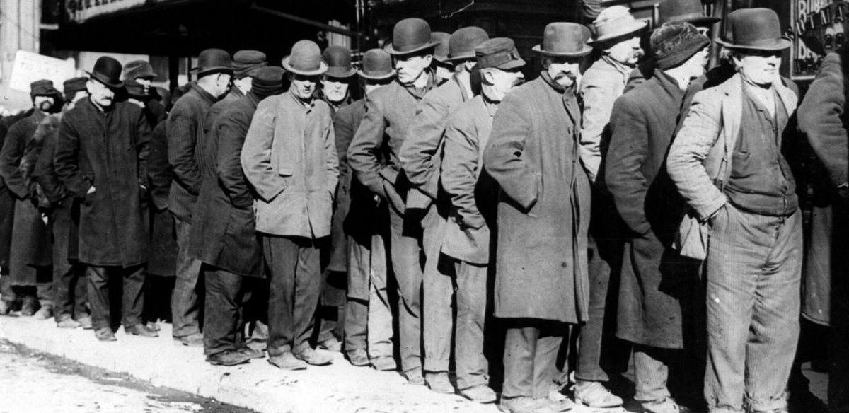 Public domain photo George Grantham Bain Collection (Library of Congress). https://commons.wikimedia.org/wiki/File:Bowery_men_waiting_for_bread_in_bread_line,_New_York_City,_Bain_Collection.jpg