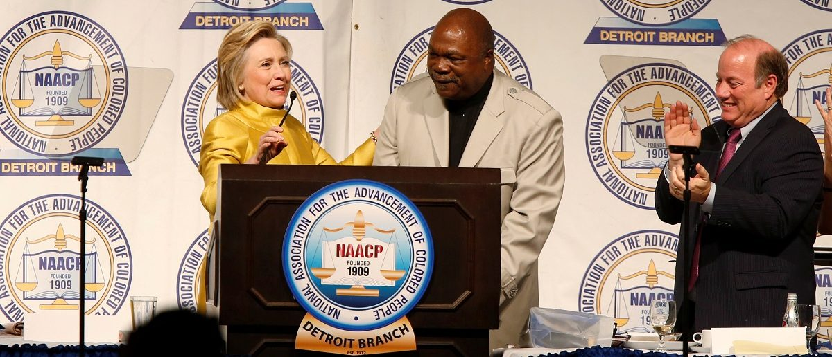 Democratic presidential candidate Hillary Clinton (L) is introduced by NAACP Detroit chapter president Wendell Anthony as Detroit Mayor Mike Duggan watches during the 61st Annual NAACP 'Fight For Freedom Fund Dinner' in Detroit, Michigan May 1, 2016. REUTERS/Rebecca Cook