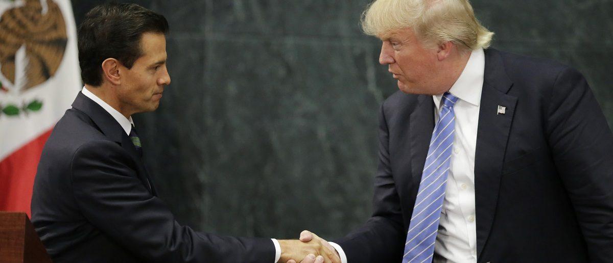 U.S. presidential nominee Trump and Mexico's President Pena Nieto shake hands in Mexico City