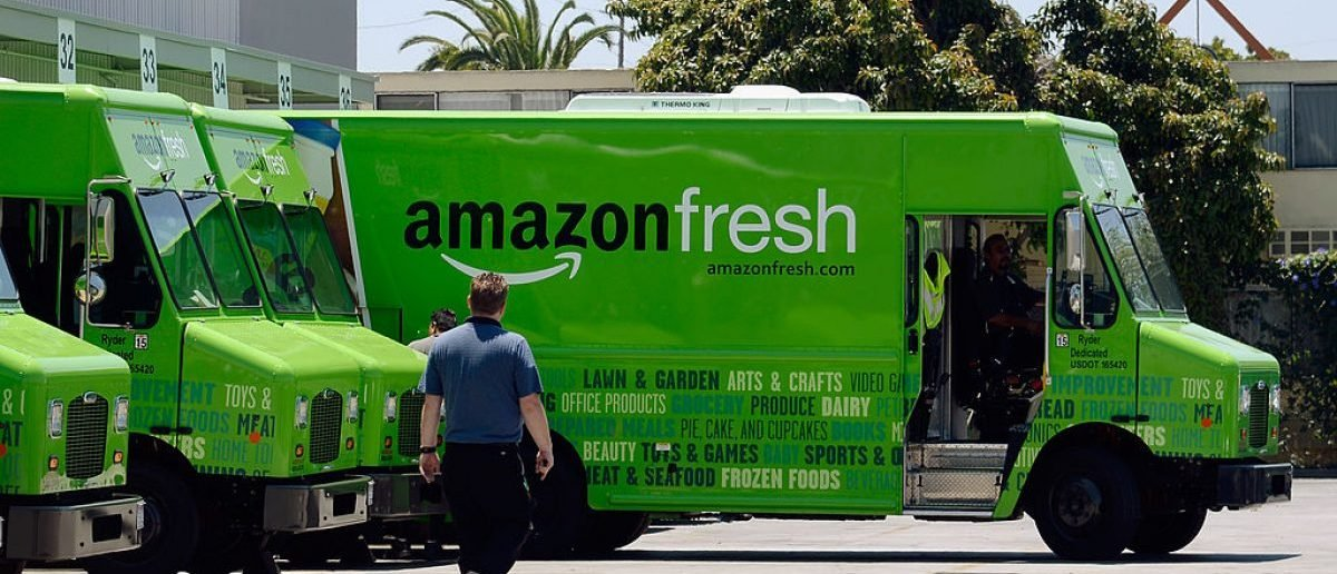 INGLEWOOD, CA - JUNE 27:  An Amazon Fresh truck arrives at a warehouse. AmazonFresh lets you order groceries and have them delivered on the same day. (Photo by Kevork Djansezian/Getty Images)