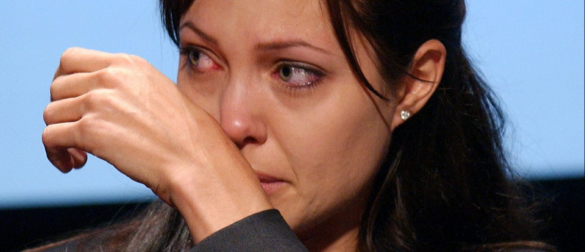Actress Angelina Jolie cries during a World Refugee Day ceremony June 20, 2003 in Washington, D.C.