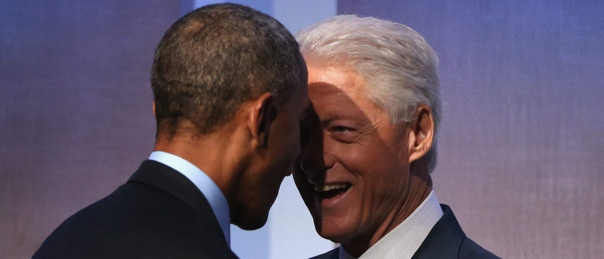 NEW YORK, NY - SEPTEMBER 23: U.S. President Barack Obama and Former U.S. President Bill Clinton speak before Obama's speech at the Clinton Global Initiative (CGI), on September 23, 2014 in New York City. The annual meeting, established in 2005 by President Clinton, convenes global leaders to discuss solutions to world problems. (Photo by John Moore/Getty Images)