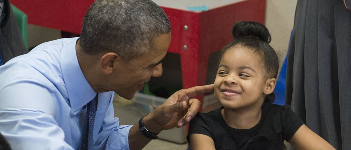 US President Barack Obama talks with Akira Cooper during a visit to a classroom at the Community Children's Center, one of the country's oldest Head Start providers. Saul Loeb/AFP/Getty Images