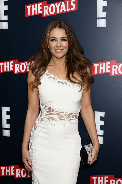 Elizabeth Hurley looking amazing in a white dress. (Photo credit: Getty Images)