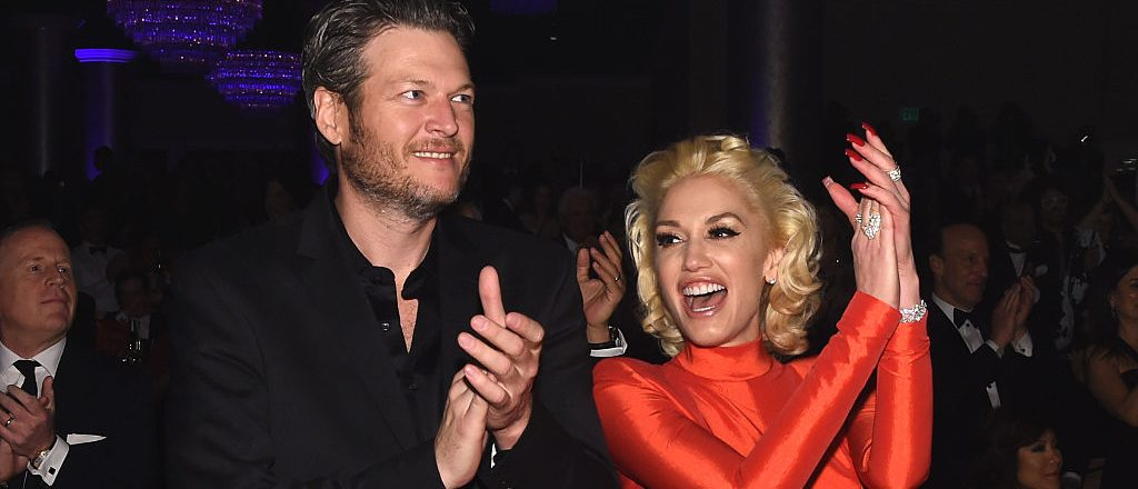 Recording artists Blake Shelton and Gwen Stefani attend the 2016 Pre-GRAMMY Gala and Salute to Industry Icons honoring Irving Azoff at The Beverly Hilton Hotel on February 14, 2016 in Beverly Hills, California