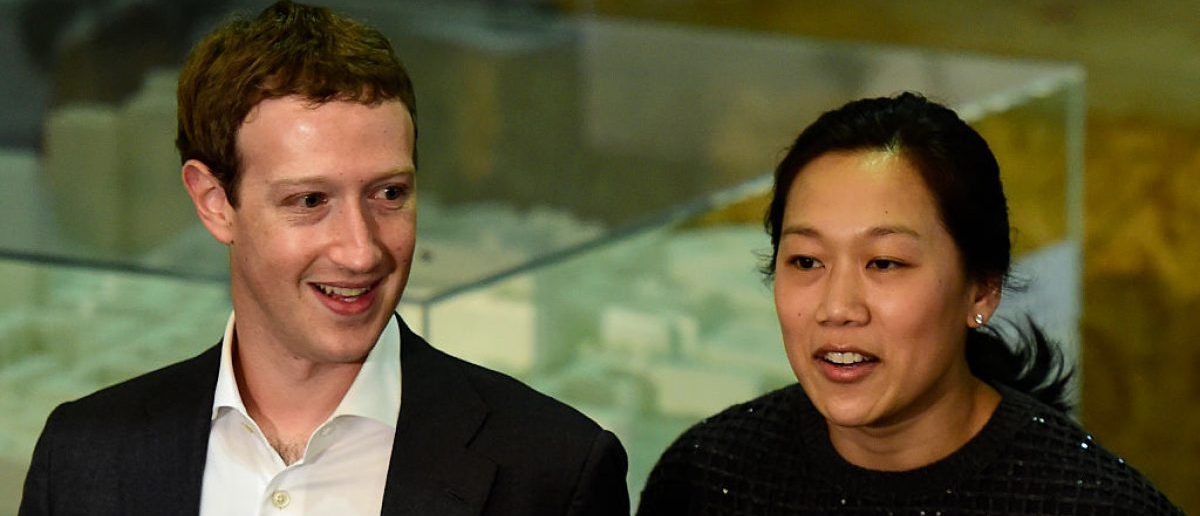 Facebook founder and CEO Mark Zuckerberg (L) arrives to receive the Axel Springer Award with his wife Priscilla Chan in Berlin on February 25, 2016. [JOHN MACDOUGALL/AFP/Getty Images]