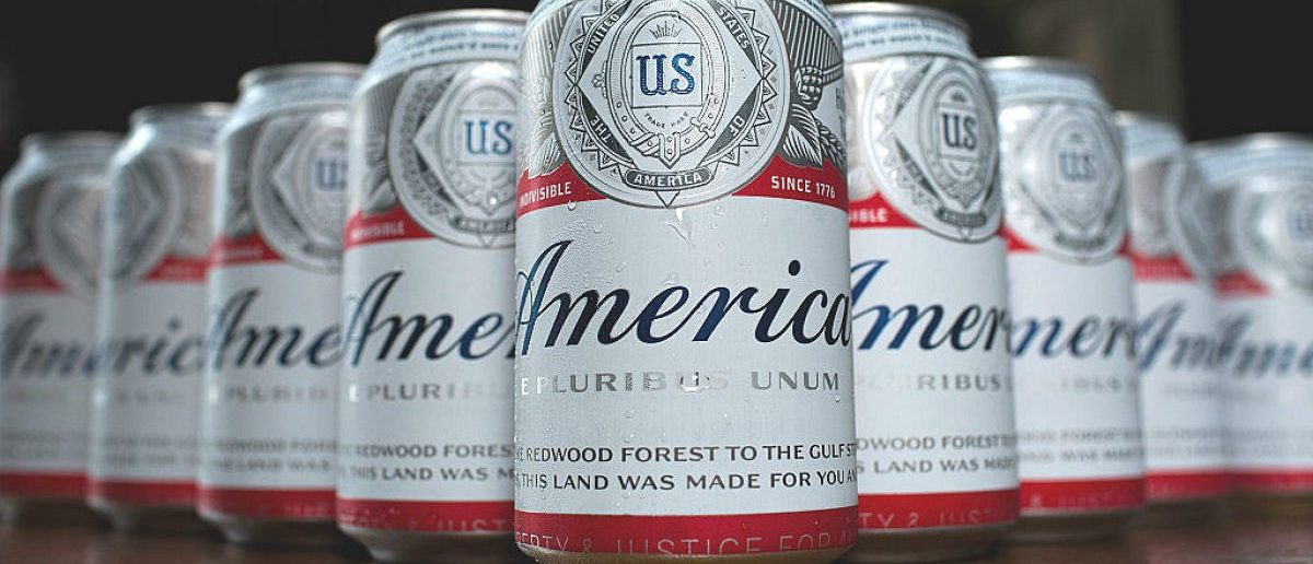 Cans of Budweiser, rebranded as 'America,' sit on a table, May 23, 2016, in Washington, DC. As part of an advertising campaign, cans and bottles of Budweiser will be labeled as 'America' instead of 'Budweiser' from now until the November 4th election. (Photo by Drew Angerer/Getty Images)