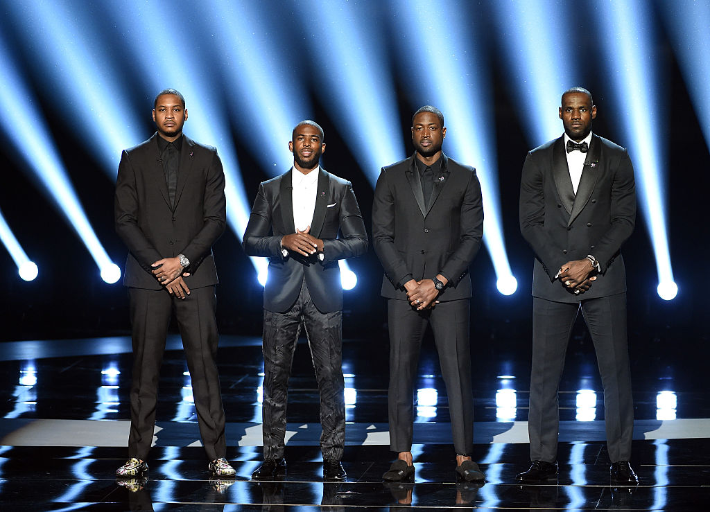 NBA players Carmelo Anthony, Chris Paul, Dwyane Wade and LeBron James speak onstage during the 2016 ESPYS. (Photo by Kevin Winter/Getty Images)