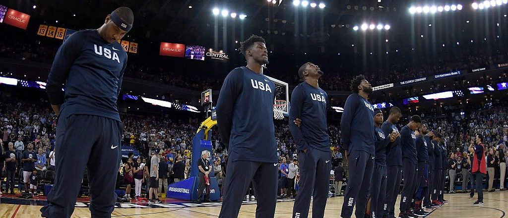 The United States Men's National Basketball Team stands together during the playing of the National Anthem prior to playing the China Men's National Team in a USA Basketball showcase exhibition game at ORACLE Arena on July 26, 2016 in Oakland, California. (Photo by Thearon W. Henderson/Getty Images)