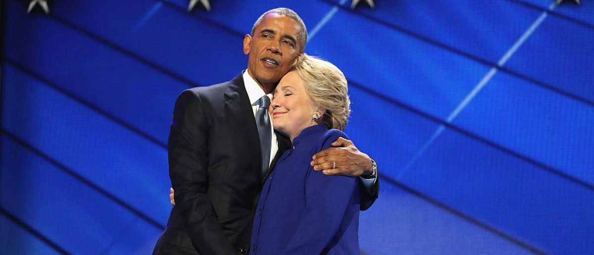 PHILADELPHIA, PA - JULY 27:  US President Barack Obama and Democratic presidential candidate Hillary Clinton embrace on the third day of the Democratic National Convention at the Wells Fargo Center. (Photo by Joe Raedle/Getty Images)