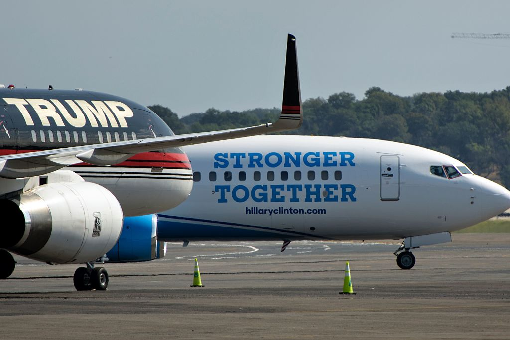 Donald Trump and Hillary Clinton's planes are seen at Ronald Reagan Washington National Airport on September 16, 2016 (Photo credit: Brendan Smialowski/AFP/Getty Images)