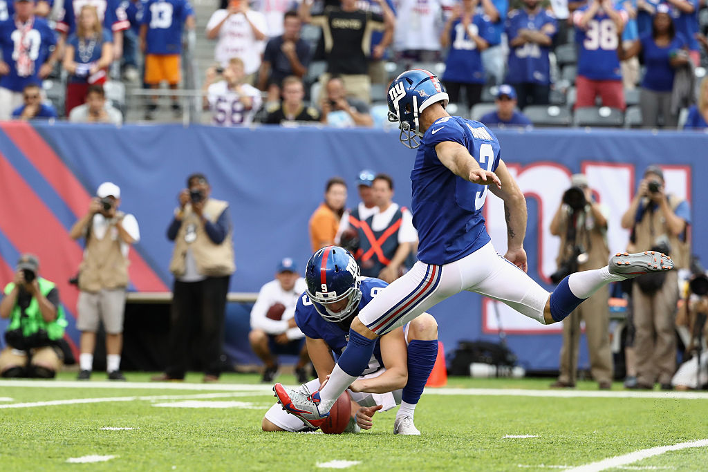Kicker Josh Brown #3 of the New York Giants kicks the game-winning field goal against the New Orleans Saints. (Photo by Elsa/Getty Images)