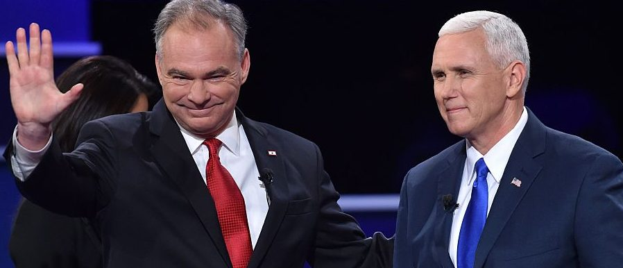 Democratic vice presidential candidate Tim Kaine (L) and Republican vice presidential candidate Mike Pence (R) arrive on stage for the US vice presidential debate at Longwood University in Farmville, Virginia on October 4, 2016