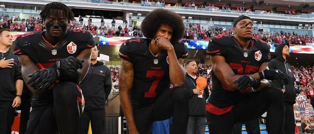 Colin Kaepernick continues his national anthem protest. (Photo by Thearon W. Henderson/Getty Images)