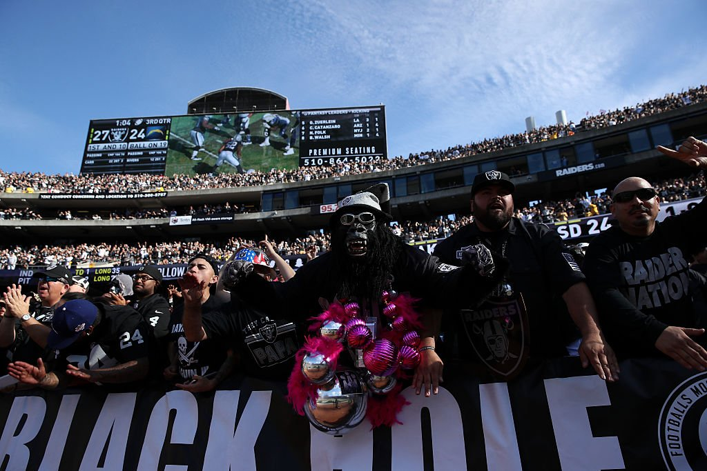 Fans cheer in the stands during the NFL game between the Oakland Raiders and the San Diego Chargers in Oakland, California. (Photo by Ezra Shaw/Getty Images)