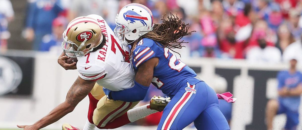 Colin Kaepernick #7 of the San Francisco 49ers is tackled by Stephon Gilmore #24 of the Buffalo Bills during the second half at New Era Field on October 16, 2016 in Buffalo, New York