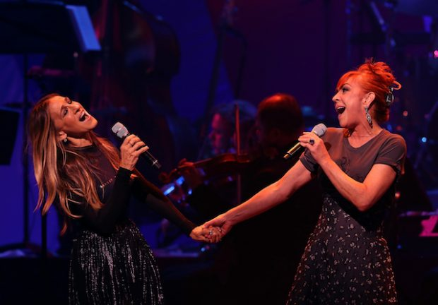 NEW YORK, NY - OCTOBER 17: Sarah Jessica Parker (L) and Andrea McArdle perform during the Hillary Victory Fund - Stronger Together concert at St. James Theatre on October 17, 2016 in New York City. Broadway stars and celebrities performed during a fundraising concert for the Hillary Clinton campaign. (Photo by Justin Sullivan/Getty Images)